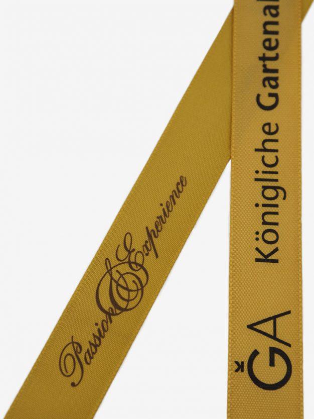 geschenkband-bedruckt-mit-firmenlogo-gold
